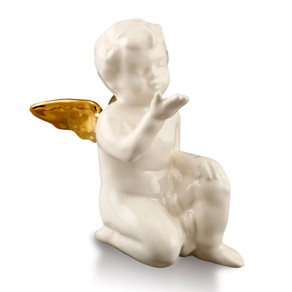 Ceramic angel statue blowing a kiss