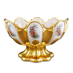 Ceramic pedestal bowl with gold accents with floral detail