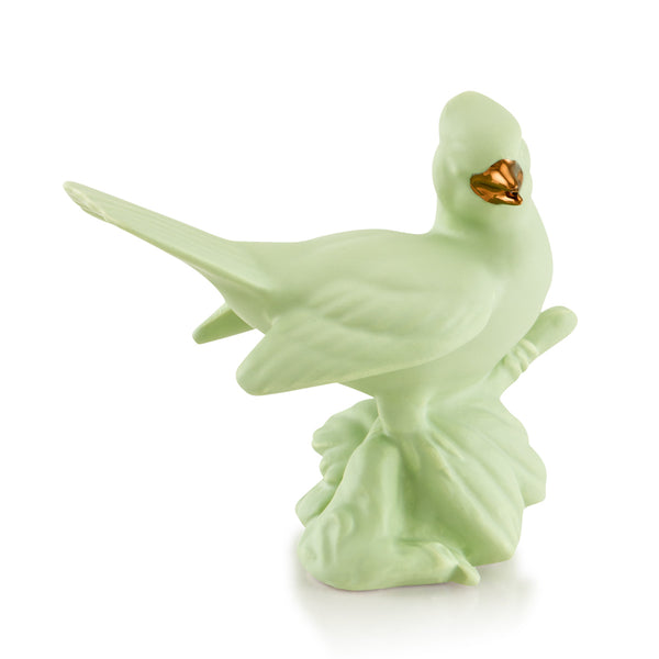 Ceramic pretty bird on trunk - green