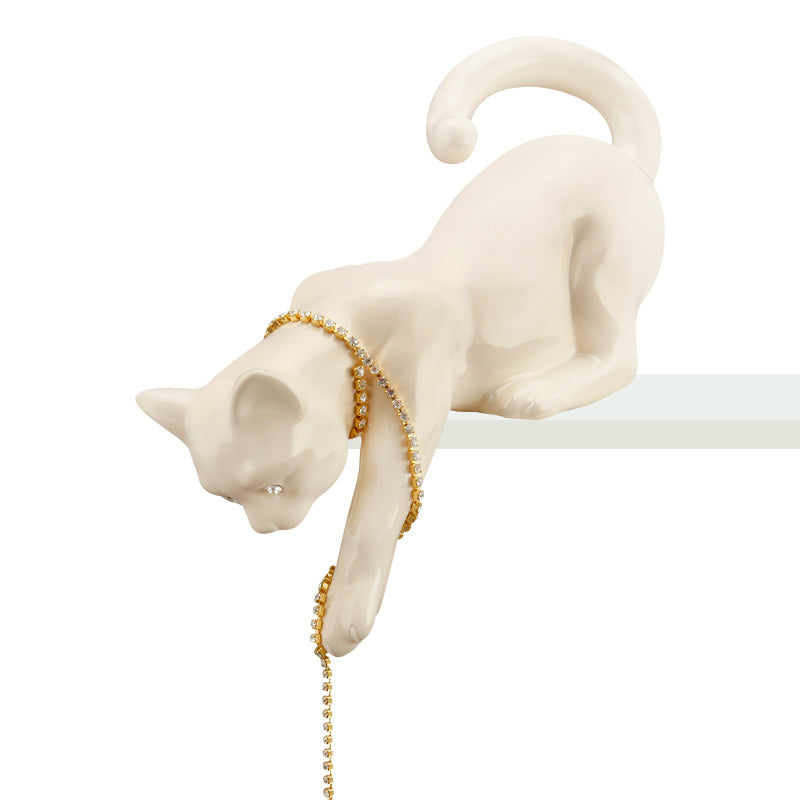 Ceramic cat playing with chain