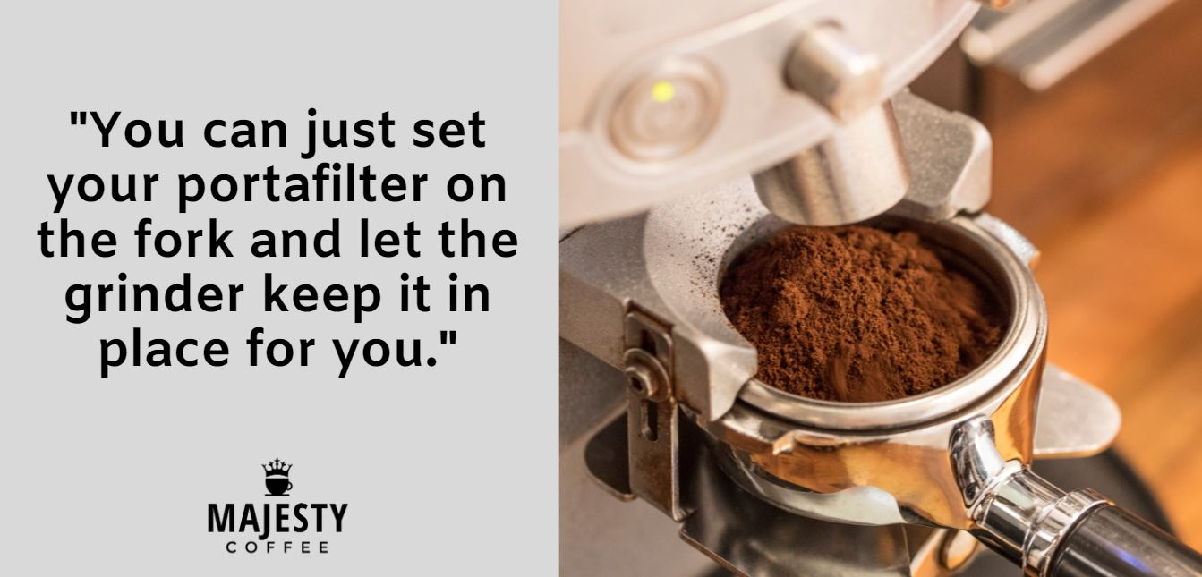 You can just set your portafilter on the fork and let the grinder keep it in place for you.