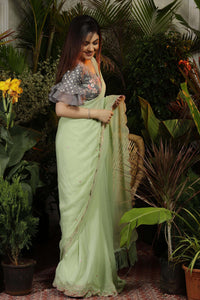 Green Cutwork Saree with Grey Ruffle Sleeve Blouse