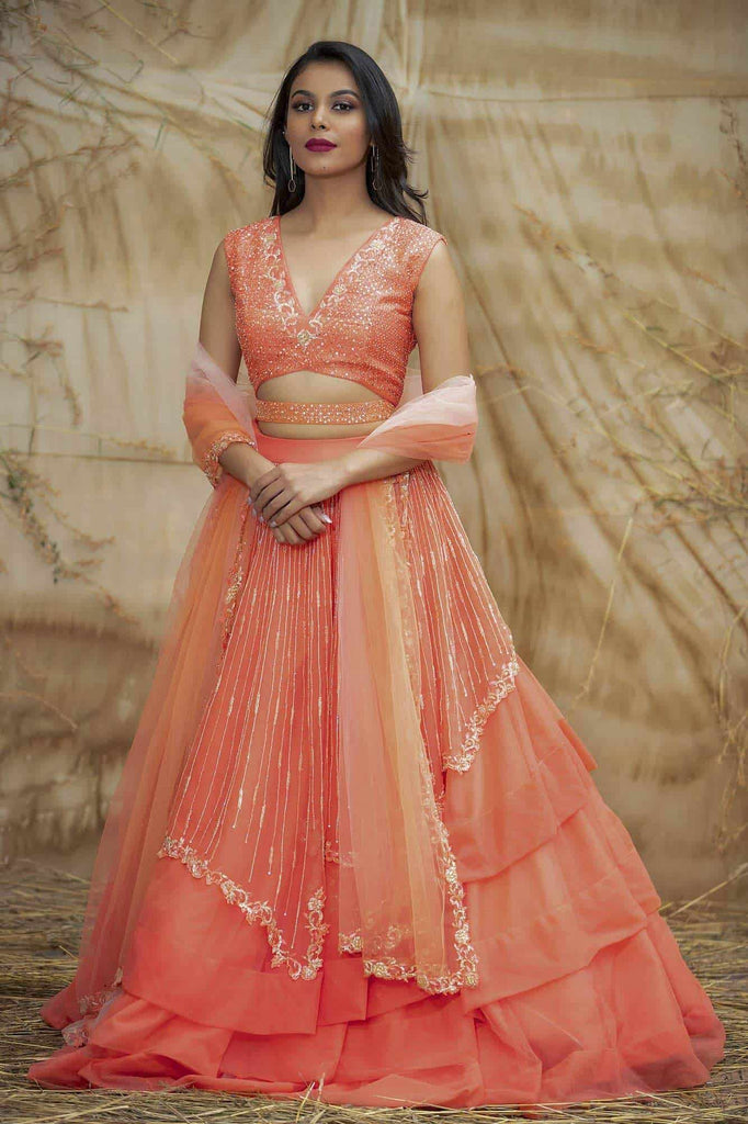 Coral net lehenga with Asymmetrical flare.