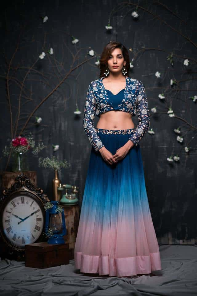 Dark blue to pink ombre lehenga with blue embroidered shrug.. - Issa Studio