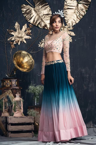 Blue to pink Ombre lehenga with peach sheer blouse.