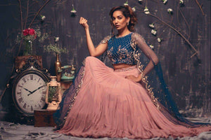 Mauve layered lehenga with teal blue scalloped cape sleeves blouse