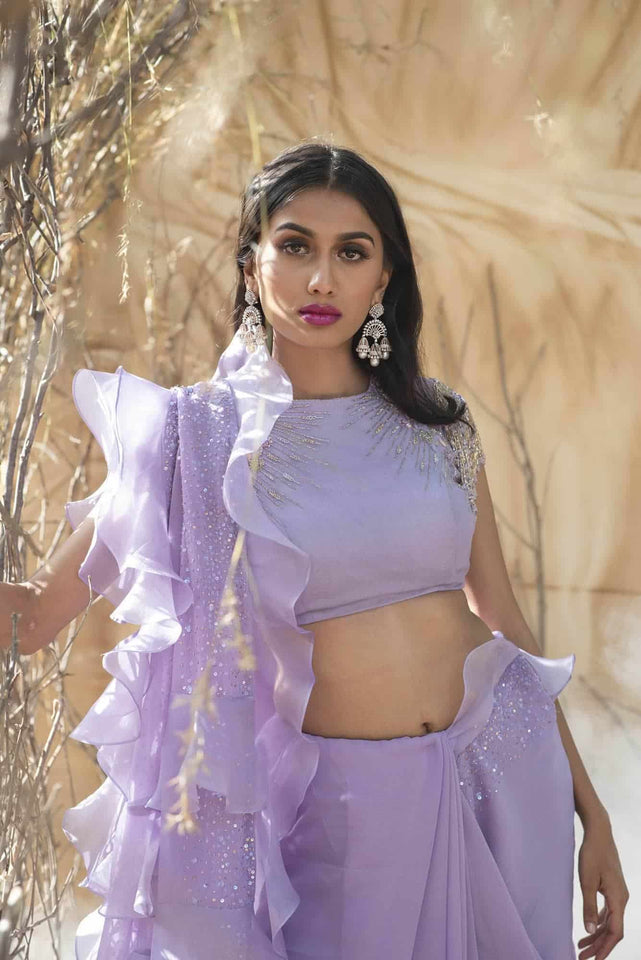 Powder Purple georgette ruffle saree with fringes blouse