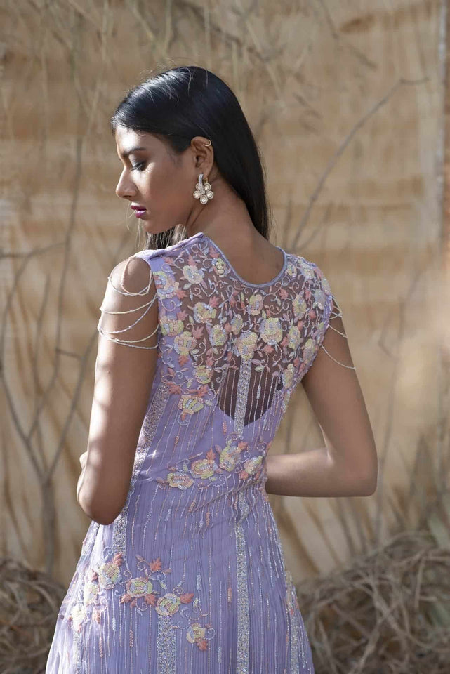 Lavender Sleeveless net gown with feather and Crystal work