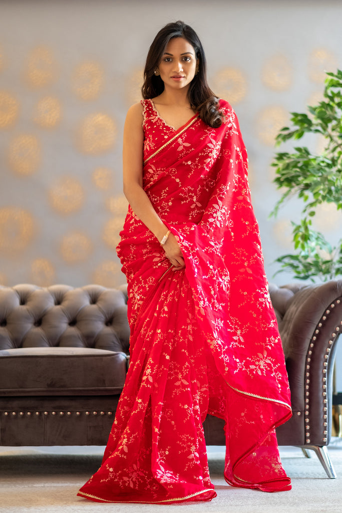 Red Chikankari organza saree with sleeveless blouse