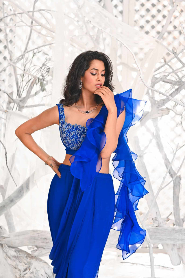 IS-BR-58 Inka Blue draped ruffle saree with crystal work sleeveless blouse.