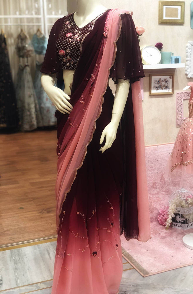 Maroon to peach ombre cutwork saree with bat sleeves blouse