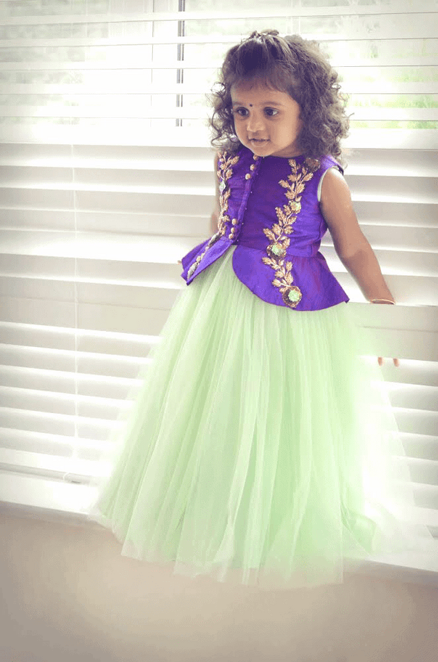 Green net frock with purple embroidered peplum