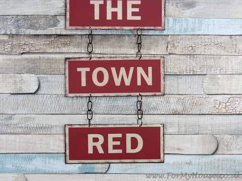 Paint The Town Red metal hanging sign