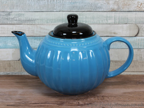 Blue ceramic teapot with black lid