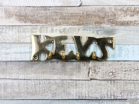 Gold coloured metal keys key rack