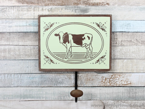 Cow plaque coat hook