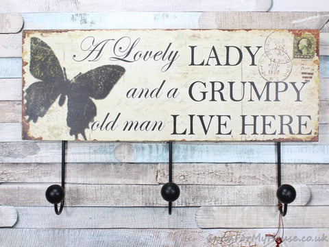 A lovely lady and a grumpy old man coat rack