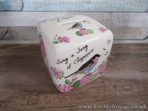 Sing a song of sixpence money box with posies and bird