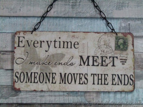 Everytime I make ends meet, someone moves the ends. plaque sign