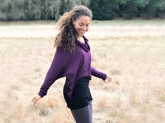 women's plant-based rayon jersey top with dolman sleeves, thumbholes in berry purple.