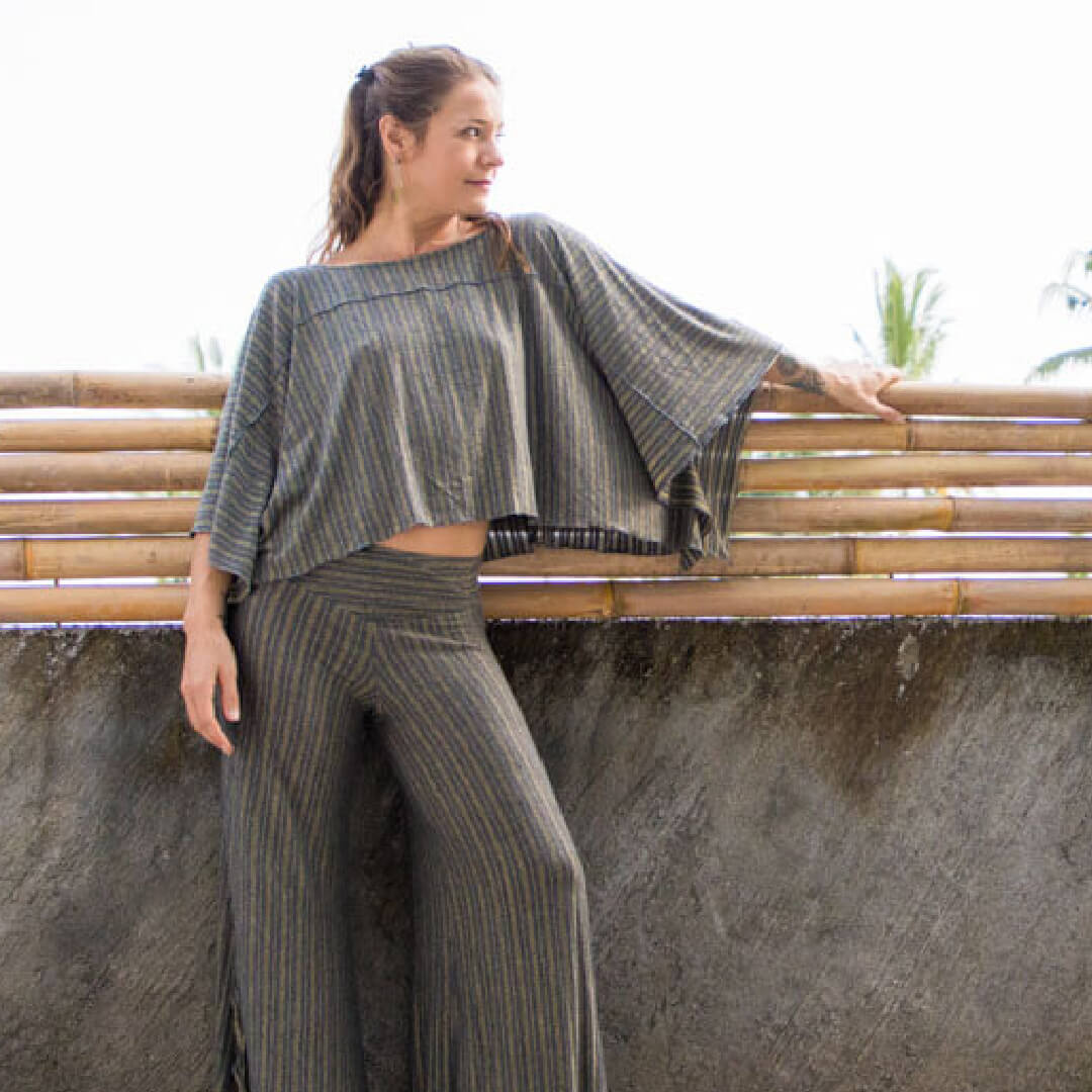 caraucci collection of plant based jersey soft and stretchy pants, tops, ponchos in gold stripes and prints