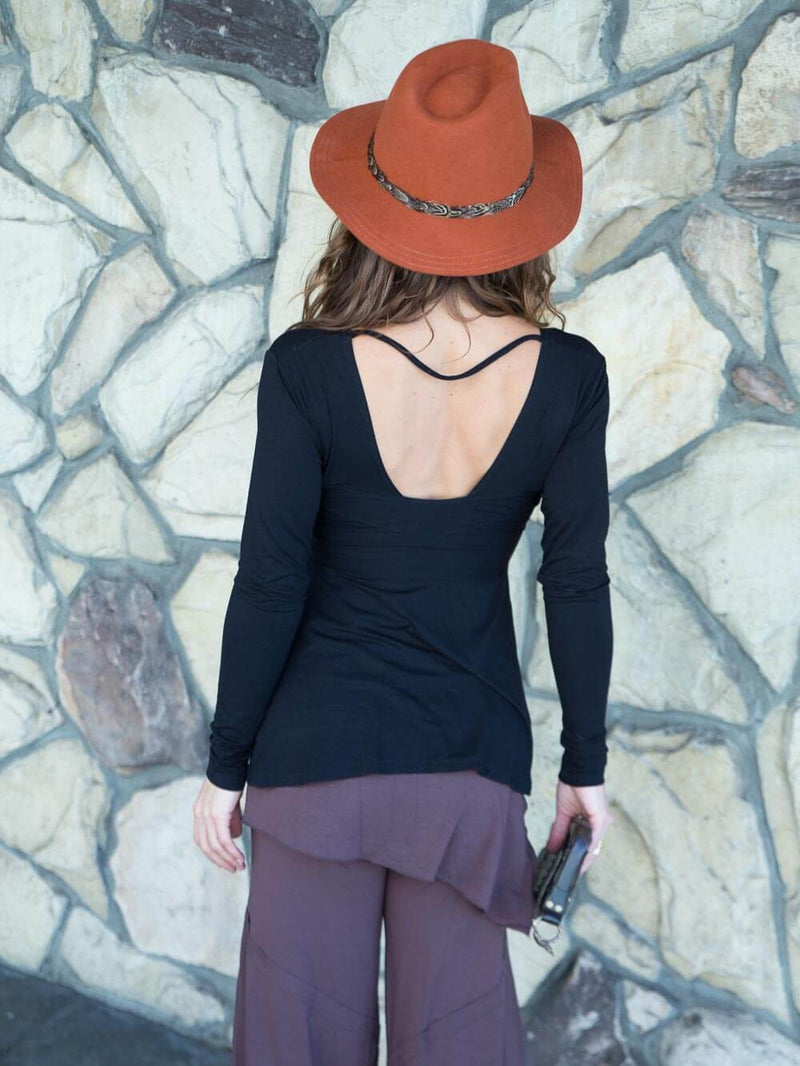 women's long sleeve plant-based rayon jersey top with deep twist v-neck #color_black