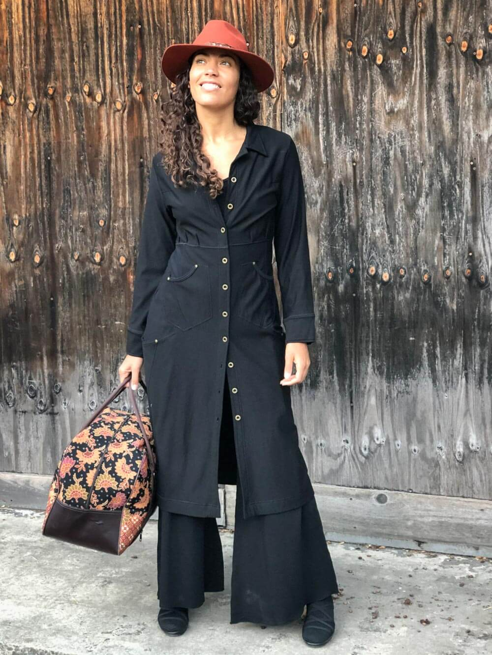 caraucci bamboo spandex black coat dress with 6 pockets and buttons up the front, can be worn as a jacket or dress #color_black