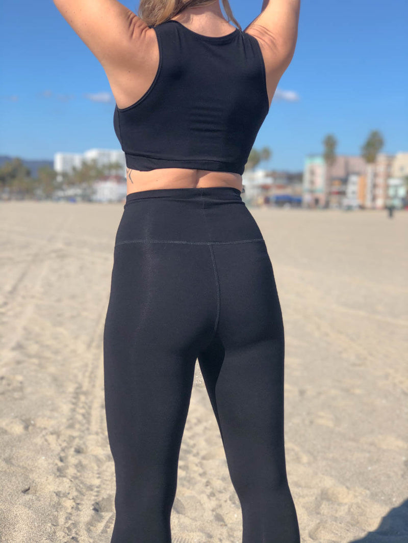 womens bamboo spandex full length leggings with a pocket and fold over waistband back view #color_black