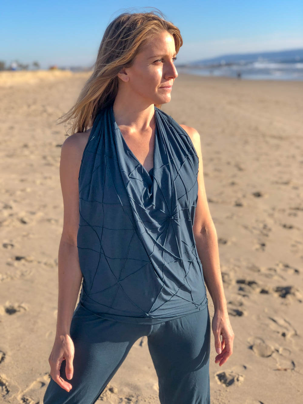 caraucci women's plant based rayon jersey teal blue textured poncho can be worn multiple ways; show as a halter top #color_teal