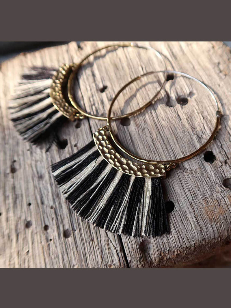 brass hoop earrings with delicate black and cream fringe thread with sterling silver ear wires.
