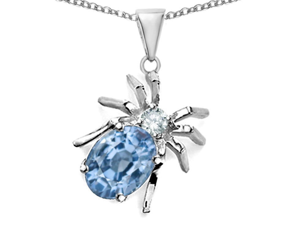 Star K Spider Pendant Necklace with Oval Simulated Aquamarine Sterling Silver