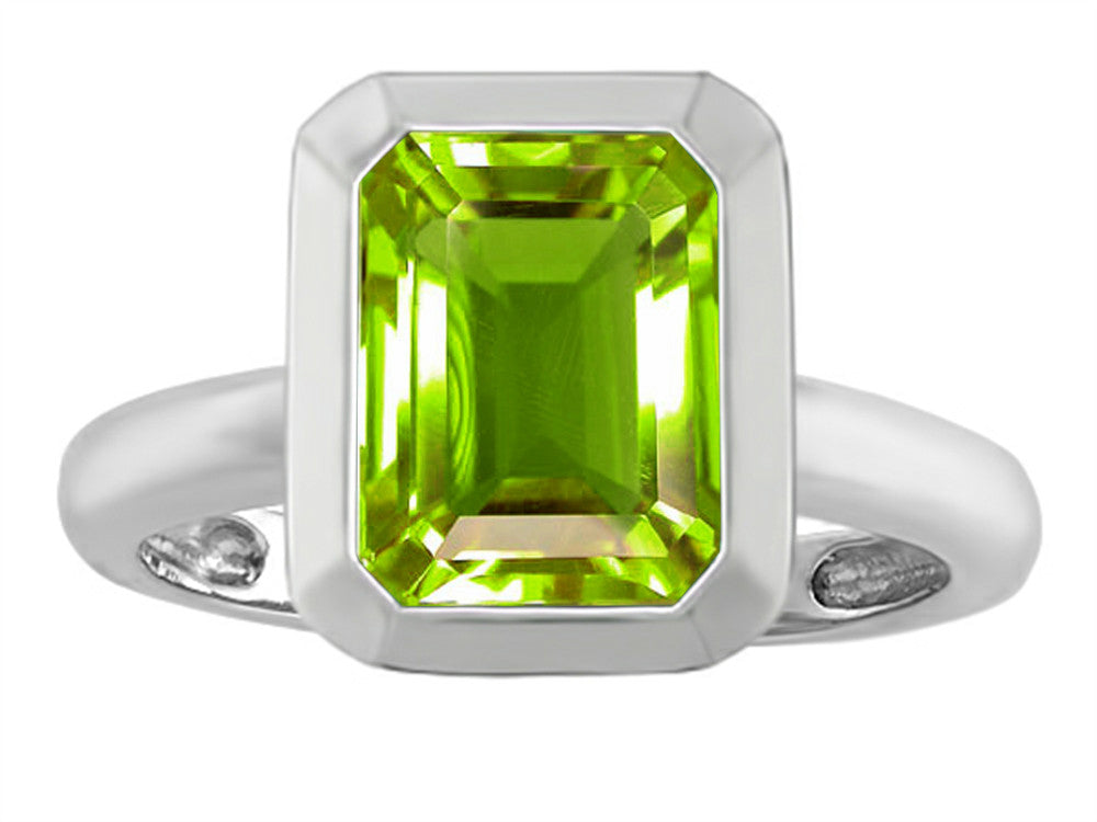 Star K 9x7mm Emerald Cut Octagon Solitaire Ring With Simulated Peridot