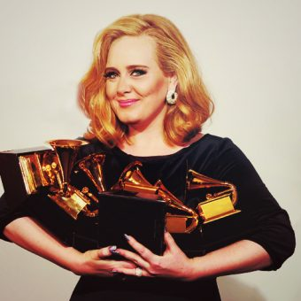 Adele-holds-many-trophies