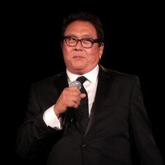Robert-Kiyosaki-wears-a-black-suit