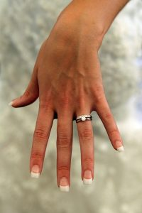 Woman-wears-a-ring-on-a-finger