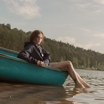 Woman-sits-in-a-boat