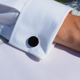 Man's-white-sleeve-with-black-cufflinks