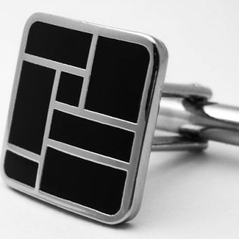 Black-cufflinks-on-white-background