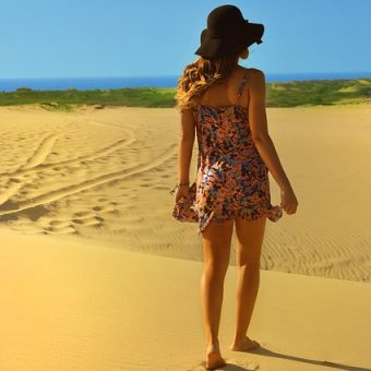 Girl-walks-on-sand