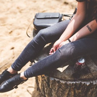 Girl with-jeans-sits-on-the-tree