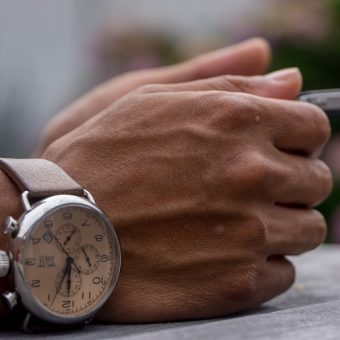 Man-having-a-watch-on-his-hand