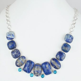 White-mannequin-wears-necklace-with-blue-gems