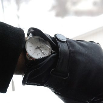 Hand-with-leather-black-gloves-and-watch