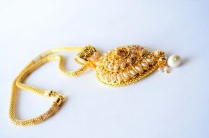 Gold-necklace-on-white-background