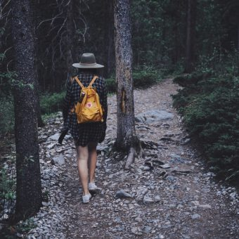 Woman-walks-through-forest