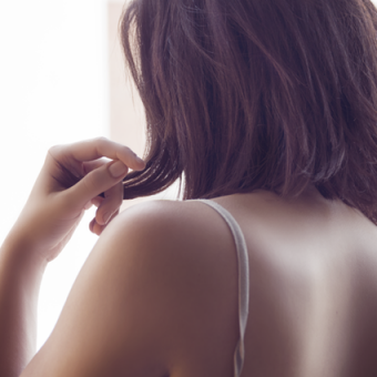 Woman-touches-her-hair