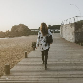 Woman-walks-beside-the-beach