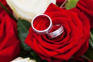 Two-engagement-rings-and-some-roses
