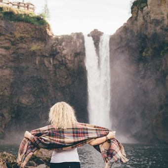 Girl-watches-the-waterfall