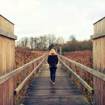 Woman-is-walking-through-a-bridge